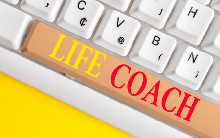 Conceptual hand writing showing Life Coach. Concept meaning A demonstrating who advices clients how to solve their problems or goals White pc keyboard with note paper above the white background