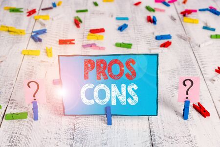 Word writing text Pros Cons. Business photo showcasing The favorable and unfavorable factors or reasons of demonstrating Scribbled and crumbling sheet with paper clips placed on the wooden table