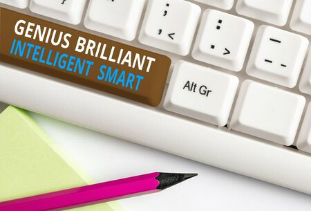 Writing note showing Genius Brilliant Intelligent Smart. Business concept for Clever Bright Knowledge Intelligence White pc keyboard with note paper above the white background