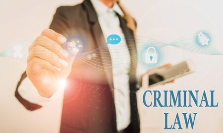 Handwriting text writing Criminal Law. Conceptual photo legal system which relates to punishing those commits crime Female human wear formal work suit presenting presentation use smart device