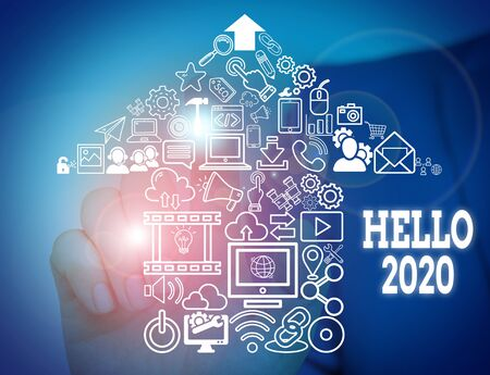 Conceptual hand writing showing Hello 2020. Concept meaning expression or gesture of greeting answering the telephone Male wear formal suit presenting presentation smart device