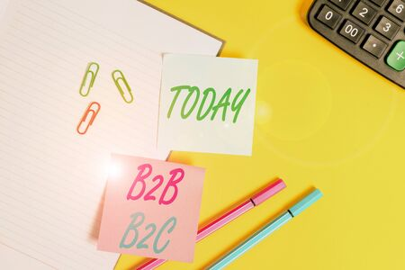 Text sign showing B2B B2C. Business photo showcasing two types for sending emails to other showing Outlook accounts Empty blue paper with copy space paper clips and pencils on the yellow table
