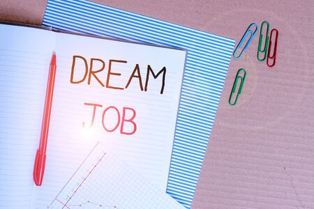 Writing note showing Dream Job. Business concept for An act that is paid of by salary and giving you hapiness Striped paperboard notebook cardboard office study supplies chart paper 写真素材