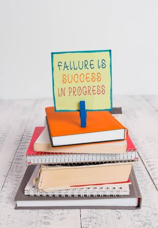 Word writing text Failure Is Success In Progress. Business photo showcasing You have to make mistakes for improvement pile stacked books notebook pin clothespin colored reminder white wooden
