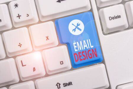Conceptual hand writing showing Email Design. Concept meaning reusable HTML file that is used to build email campaigns Keyboard with note paper on white background key copy space Stockfoto