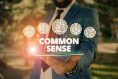 Word writing text Common Sense. Business photo showcasing having good sense and sound judgment in practical matters Male human wear formal work suit presenting presentation using smart device