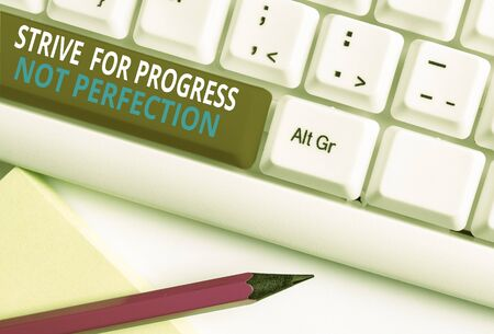 Writing note showing Strive For Progress Not Perfection. Business concept for Improve with flexibility Advance Grow White pc keyboard with note paper above the white background 写真素材