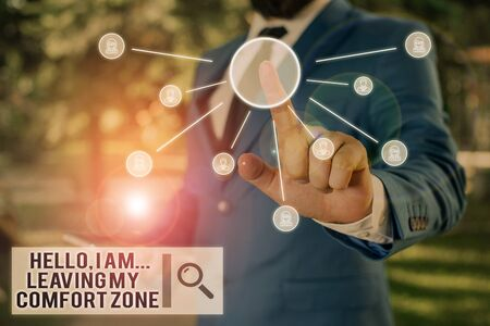 Text sign showing Hello I Am Leaving My Comfort Zone. Business photo text Making big changes Evolution Growth Male human wear formal work suit presenting presentation using smart device Stok Fotoğraf