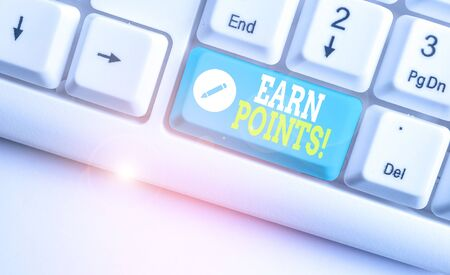 Handwriting text Earn Points. Conceptual photo collecting scores in order qualify to win big prize White pc keyboard with empty note paper above white background key copy space