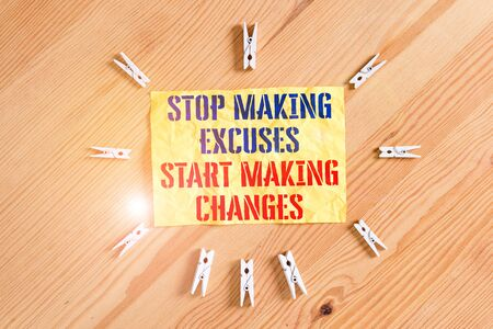 Writing note showing Stop Making Excuses Start Making Changes. Business concept for Do not give an excuse Act instead Colored clothespin papers empty reminder wooden floor background office