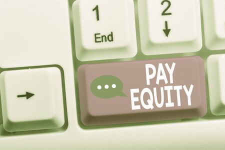 Writing note showing Pay Equity. Business concept for eliminating sex and race discrimination in wage systems White pc keyboard with note paper above the white background