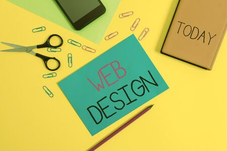Handwriting text writing Web Design. Conceptual photo who is responsible of production and maintenance of websites Paper sheets pencil clips smartphone scissors notebook colored background