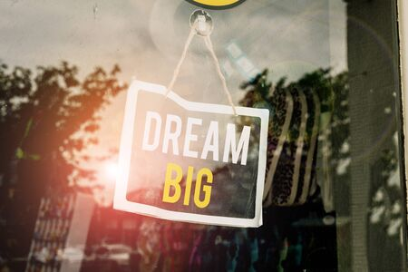 Text sign showing Dream Big. Business photo text To think of something high value that you want to achieve Empty black board with copy space for advertising. Blank dark board