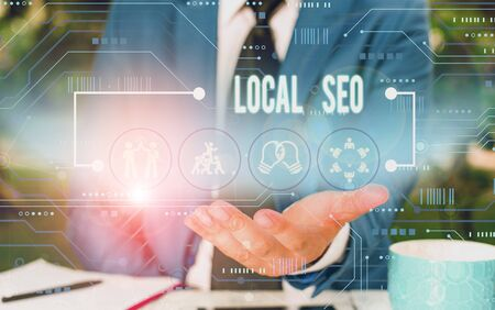 Text sign showing Local Seo. Business photo showcasing This is an effective way of marketing your business online Male human wear formal work suit presenting presentation using smart device