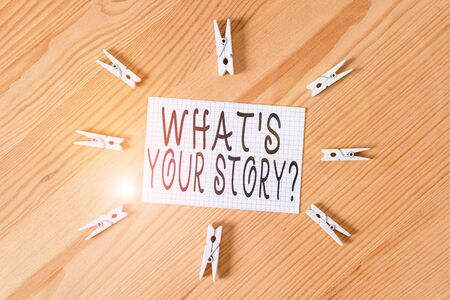 Conceptual hand writing showing What S Your Story Question. Concept meaning asking demonstrating about his past life actions career or events Colored crumpled papers wooden floor background clothespin Stok Fotoğraf