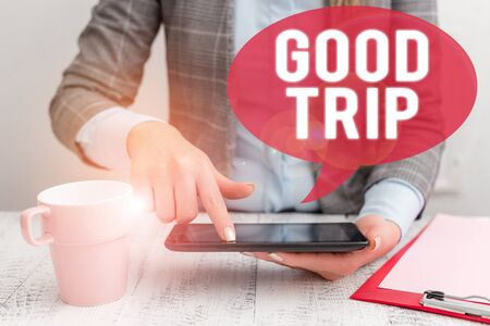 Text sign showing Good Trip. Business photo showcasing A journey or voyage,run by boat,train,bus,or any kind of vehicle Business woman sitting with mobile phone and cup of coffee on the table