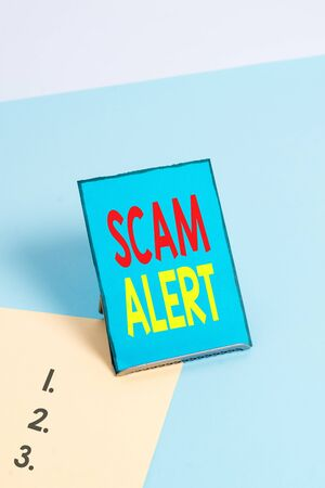 Writing note showing Scam Alert. Business concept for warning someone about scheme or fraud notice any unusual