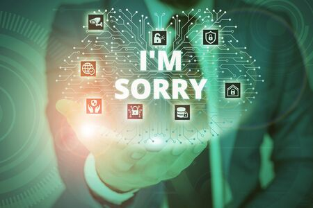 Conceptual hand writing showing I M Sorry. Concept meaning Toask for forgiveness to someone you unintensionaly hurt Male wear formal suit presenting presentation smart device