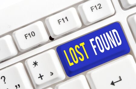 Text sign showing Lost Found. Business photo showcasing Things that are left behind and may retrieve to the owner White pc keyboard with empty note paper above white background key copy space 版權商用圖片