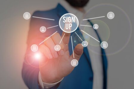 Writing note showing Sign Up. Business concept for use your information to register in website team college or blog Male wear formal work suit presenting presentation smart device Foto de archivo
