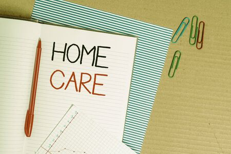 Writing note showing Home Care. Business concept for Place where showing can get the best service of comfort rendered Striped paperboard notebook cardboard office study supplies chart paper Stok Fotoğraf