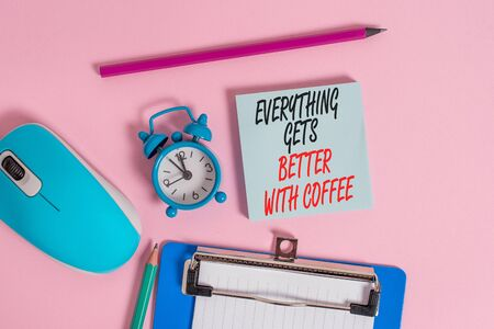Conceptual hand writing showing Everything Gets Better With Coffee. Concept meaning Have a hot drink when having problems Alarm clock notepad clipboard paper markers color background