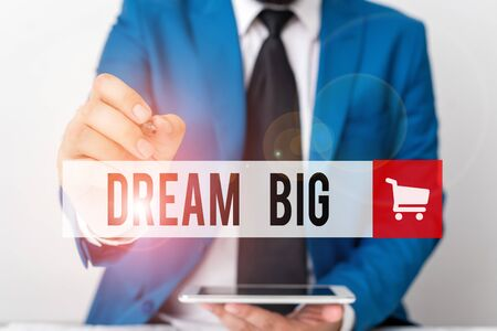 Word writing text Dream Big. Business photo showcasing To think of something high value that you want to achieve Businessman pointing with pen in empty copy space Reklamní fotografie