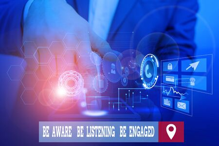 Handwriting text writing Be Aware Be Listening Be Engaged. Conceptual photo take attention to actions or speakers Male human wear formal work suit presenting presentation using smart device Stockfoto