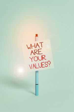Text sign showing What Are Your Values Question. Business photo showcasing asking someone about his good qualities Ballpoint blank colored sticky note peaceful cool pastel fashion background