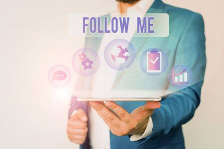 Text sign showing Follow Me. Business photo text Inviting a demonstrating or group to obey your prefered leadership Male human wear formal work suit presenting presentation using smart device