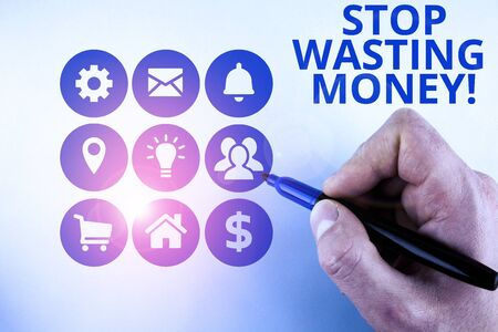 Conceptual hand writing showing Stop Wasting Money. Concept meaning advicing demonstrating or group to start saving and use it wisely Male designing layout presentation concept for business promotion