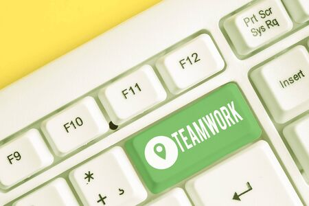 Text sign showing Teamwork. Business photo text Group of showing who work together as one and with the same aim White pc keyboard with empty note paper above white background key copy space