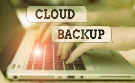 Writing note showing Cloud Backup. Business concept for enable customers to remotely access the provider s is services woman with laptop smartphone and office supplies technology 版權商用圖片