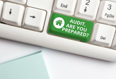 Handwriting text writing Audit Are You Prepared Question. Conceptual photo asking if he is ready to do something White pc keyboard with empty note paper above white background key copy space