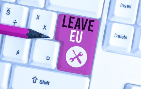 Text sign showing Leave Eu. Business photo showcasing An act of a demonstrating to leave a country that belongs to Europe White pc keyboard with empty note paper above white background key copy space