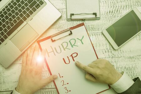 Conceptual hand writing showing Hurry Up. Concept meaning asking someone to do a job very fast Quickly Lets go Encourage Banque d'images - 130620277