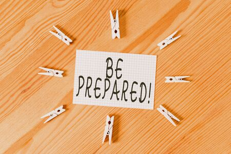 Conceptual hand writing showing Be Prepared. Concept meaning try be always ready to do or deal with something Colored crumpled papers wooden floor background clothespin