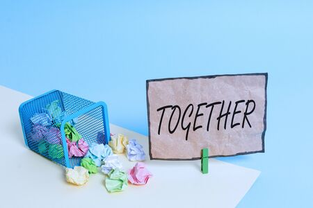 Handwriting text writing Together. Conceptual photo In proximity,union or collison with another demonstrating or things Trash bin crumpled paper clothespin empty reminder office supplies tipped