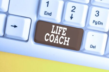Conceptual word writing showing Life Coach. Concept meaning A demonstrating who advices clients how to solve their problems or goals White pc keyboard with note paper above the white background Banco de Imagens
