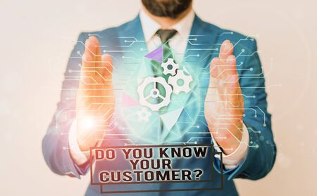 text writing Do You Know Your Customer Question. Conceptual photo Have into account client likes opinion Male human wear formal work suit presenting presentation using smart device