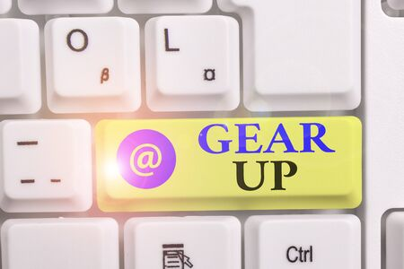 Writing note showing Gear Up. Business concept for Asking someone to put his clothes or suit on Getting ready fast White pc keyboard with note paper above the white background Archivio Fotografico