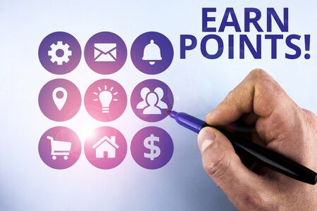 Conceptual hand writing showing Earn Points. Concept meaning collecting scores in order qualify to win big prize Male designing layout presentation concept for business promotion