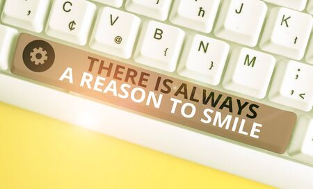 Conceptual hand writing showing There Is Always A Reason To Smile. Concept meaning Positive thinking good attitude energy White pc keyboard with note paper above the white background Banco de Imagens