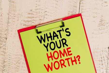 Word writing text What S Your Home Worth Question. Business photo showcasing Value of a house Property Cost Price Rate Colored clipboard blank paper sheet old retro wooden vintage background