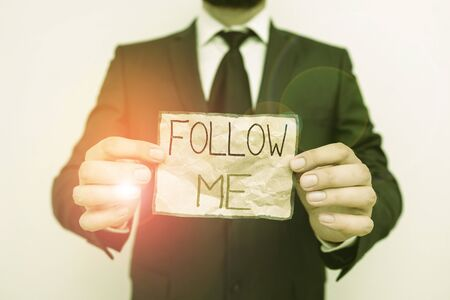 Writing note showing Follow Me. Business concept for Inviting a demonstrating or group to obey your prefered leadership