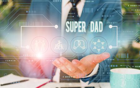 Text sign showing Super Dad. Business photo showcasing Children idol and super hero an inspiration to look upon to Male human wear formal work suit presenting presentation using smart device Stock Photo