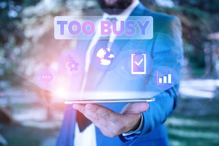 Text sign showing Too Busy. Business photo showcasing No time to relax no idle time for have so much work or things to do Male human wear formal work suit presenting presentation using smart device