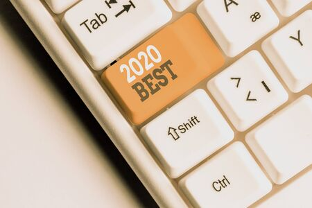 Writing note showing 2020 Best. Business concept for Highest quality done in all fields preparing for the next year White pc keyboard with note paper above the white background