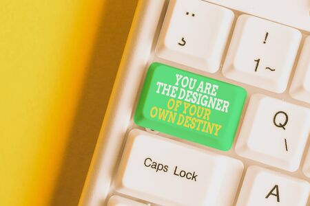 Conceptual hand writing showing You Are The Designer Of Your Own Destiny. Concept meaning Embrace life Make changes White pc keyboard with note paper above the white background