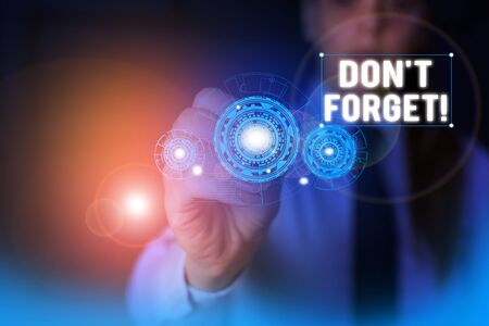 Text sign showing Don T Forget. Business photo showcasing used to remind someone about important fact or detail Woman wear formal work suit presenting presentation using smart device